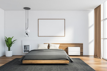 White master bedroom with horizontal poster