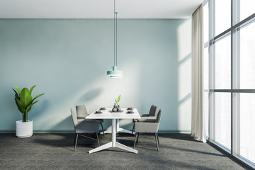 Panoramic blue dining room with grey chairs