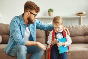Keuken foto achterwand Wanddecoratie met eigen foto Young father talking to sad schoolkid.