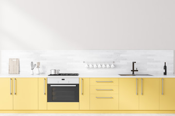 White kitchen with yellow countertops