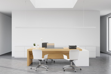 Modern white CEO office with wooden table