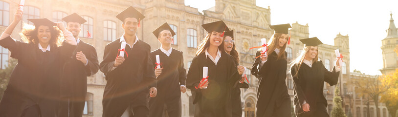 Happy students with diplomas near campus. Banner design