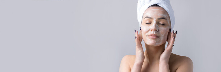 Foto op Plexiglas Spa Beauty portrait of woman in white towel on head with a sponge for a body in view of a pink heart. Skincare cleansing eco organic cosmetic spa relax concept.