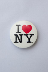 I love NY logo on a badge. This logo basis of an advertising campaign used since 1977 to promote tourism in the state of New York.