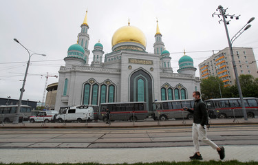 A man walks past the closed Moscow Cathedral Mosque during Eid al-Fitr, the Muslim festival marking the end the holy fasting month of Ramadan, in Moscow
