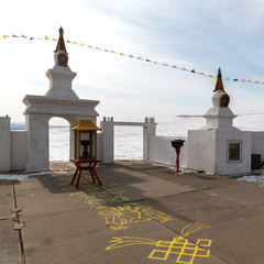 The Buddhist pray of Enlightenment in winter in sunny day at Ogoy Island, Baikal Lake , Russia