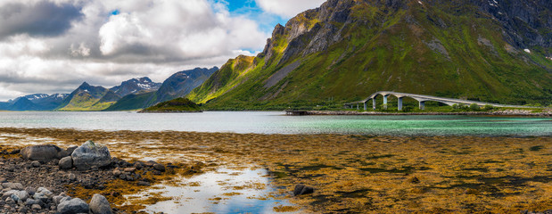 Wall Mural - Bridge connecting Lofoten Islands in Norway with surrounding mountains
