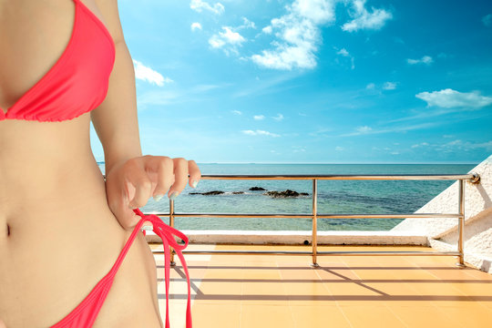 Beautiful woman showing a perfect body with red bikini