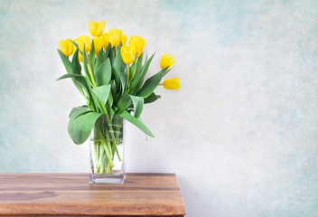 yellow tulips bouquet in vase