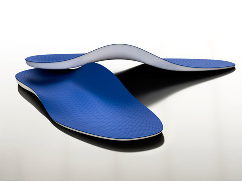 pair of tailored orthopedic insoles