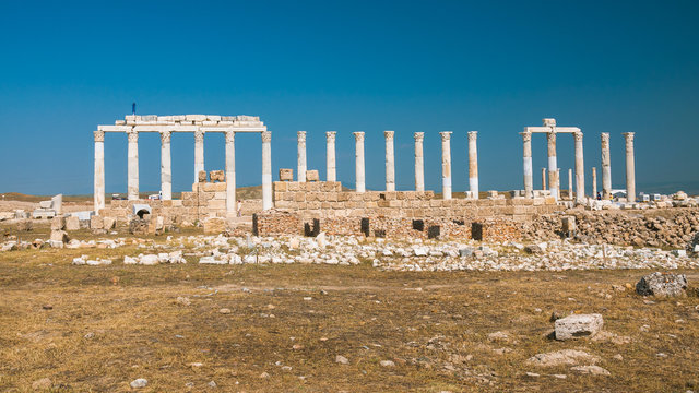 Ancient city ruins in Denizli, Turkey (Pamukkale District) with bule sky and perpendicular perspective, good view, juicy colors.