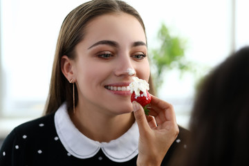 Girl stained her nose with cream from strawberries
