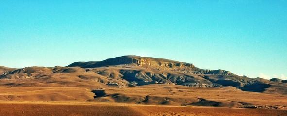 Foto auf AluDibond Turkis Scenic View Of Arid Landscape Against Clear Blue Sky