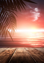 Foto auf Gartenposter Koralle Sea evening landscape with sunset. Palm tree branches, silhouettes, sunlight. Wooden table by the sea. Night view, open-air seascape. 3D illustration