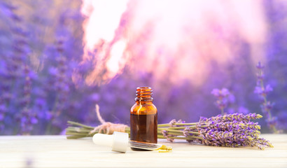 Photo sur Plexiglas Lavande Essential lavender oil in the bottle with dropper isolated on white background. Horizontal close-up. Skincare spa massage.