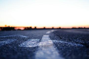 Fotomurales - Surface Level Of Asphalt Road Against The Sky