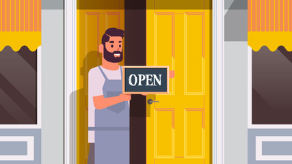 waiter holding welcome we are open sign coronavirus quarantine is ending victory over covid-19 concept street cafe exterior portrait horizontal vector illustration