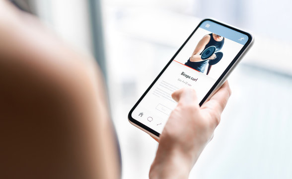 Gym training app in phone. Online personal trainer or video tutorial mockup in smartphone. Home workout with fitness class or digital sport coach. Exercise instruction. Getting fit. Mobile technology.