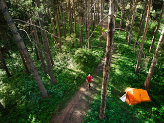 Aerial shot of tourist near camping in the forest