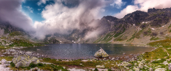 Fotomurales - Mysterious Dramatic Scene. View on Hinkovo Pleso Lake with Dramatic Sky. High Tatra. Slovakia. Awecome Nature Landscape. Popular travel and hiking destination. best places in World