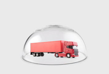 Red long truck with a trailer protected under a glass dome
