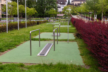 Outdoor gym. Sport exercises. Active rest. Family fitness. Gymnastic equipment. City park. Sport is health. Free exercises. Taking care of health.
