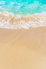 Wave on sandy beach. Panoramic background with copy space.