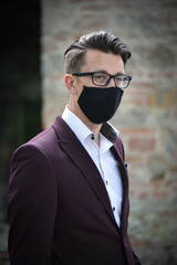 Young businessman with a face mask
