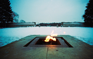 Foto auf Gartenposter Khaki Close-up Of Fire On Snowed Landscape