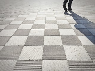 Low Section Of Man Walking On Tilted Floor Wall mural