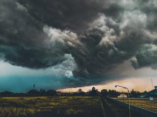 Fotomurales - Storm Clouds Over Landscape