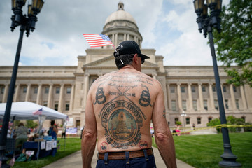 """A gun rights supporter listens to a speaker during a """"Patriot Day 2nd Amendment Rally"""" in support of gun rights at the State Capitol in Frankfort"""