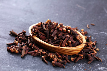 freshly dryed cloves spice texture on background