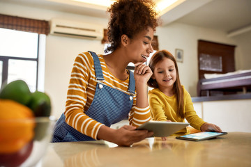 Growing future. African american woman baby sitter entertaining caucasian cute little girl. Kid showing something to her nanny. Children education, leisure activities, babysitting concept