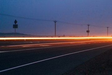 Fotomurales - Light Trails On Road Against Clear Sky At Night