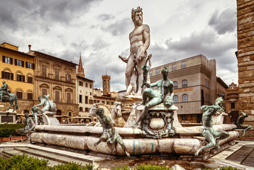 Fototapete - Fountain of Neptune with statues on Piazza della Signoria, Florence, Italy. It is tourist attraction of Florence. Luxury Renaissance architecture