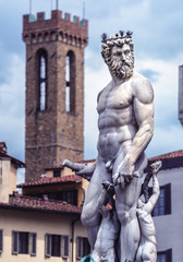 Fototapete - Statue of Neptune on Piazza della Signoria in Florence, Italy. Detail of Renaissance fountain in Florence center.