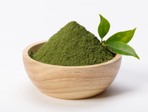 Matcha green tea powder in bowl with Organic green tea leaf isolated on white background, Organic product from the nature for healthy with traditional style