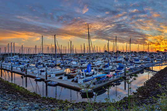 Boat marina under a dramatic sunset in National City, San Diego, California, USA