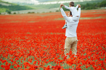 A man and a child are resting in nature. Father and son have fun in the field.