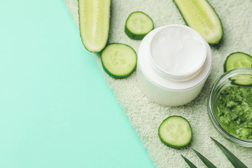 Cream with cucumber extract on color background
