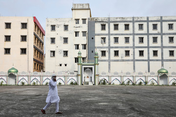 A Muslim man walks through an empty Eidgah during Eid al-Fitr, the Muslim festival marking the end of the holy fasting month of Ramadan, amid the spread of the coronavirus disease (COVID-19) outbreak in Howrah