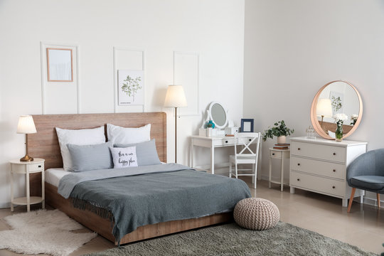 Stylish interior of bedroom with lamps