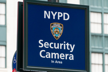 New York, USA - May 14, 2018: Warning sign indicating security camera being used by New York Police Department