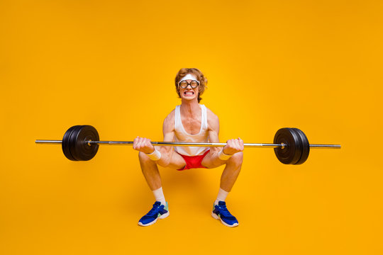 Full length body size view of nice funky motivated weak guy lifting barbell doing work out coacher trainer program regime body building isolated over bright vivid shine vibrant yellow color background