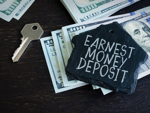 Earnest Money Deposit label and stack of money.