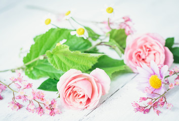 bouquet of pink roses on wooden background
