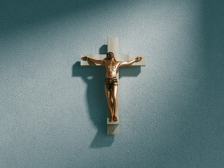 Crucifix on wall in spotlight inside old dark church or cathedral. Jesus Christ on cross. Religion, belief and hope. Holy and sacred places. 3d rendering