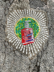 Chicago artist Jim Bachor creates four pandemic-themed pothole mosaics on the city's North Side