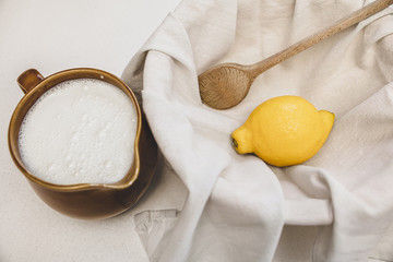 fresh cheese making recipe ingredients, milk, lemon and a cotton cloth
